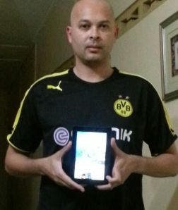 Rene Ribeiro with Kindle Fire